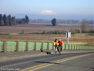 Image, 2005, Sauvie Island bicyclists, with Mount St. Helens, click to enlarge